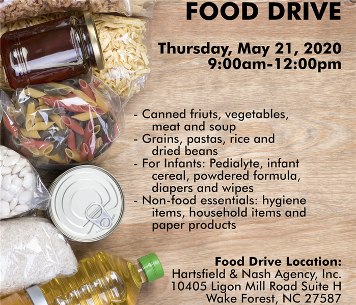 a flyer of dry foods on a table with food drive information regarding what type of food and where to bring it