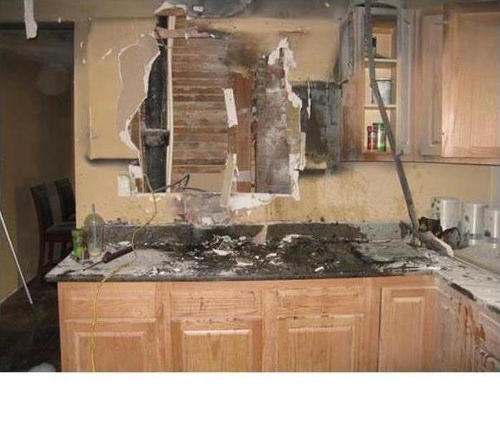 Fire damaged kitchen with smoke and soot damage