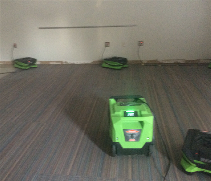SERVPRO drying equipment at work in room