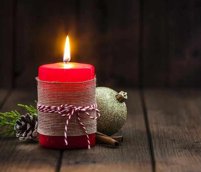 Red Christmas candle on rustic wooden table